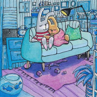 Illustrasjon av to trygge kaniner i en sofa